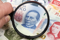 New Mexican Pesos in a magnifying glass a business background - PhotoDune Item for Sale