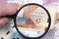 Money from Qatar in a magnifying glass a business background - PhotoDune Item for Sale