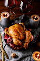 Whole roast chicken with pomegranate, apple and red wine on a festive table. - PhotoDune Item for Sale