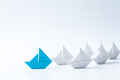 Leadership conceptual using blue paper ship - PhotoDune Item for Sale