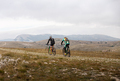 two male cyclists riding on mountain road - PhotoDune Item for Sale