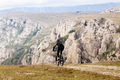 male cyclist riding on mountain trail - PhotoDune Item for Sale