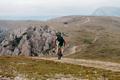 back male cyclist biking on mountain path - PhotoDune Item for Sale