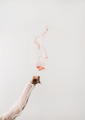 Female hand swirling glass of rose wine making splash - PhotoDune Item for Sale