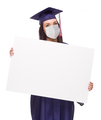 Graduating Female Wearing Medical Face Mask and Cap and Gown  Holding Blank Poster Board Isolated - PhotoDune Item for Sale