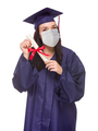 Graduating Female Wearing Medical Face Mask and Cap and Gown  Isolated on a White Background - PhotoDune Item for Sale