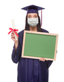 Graduating Female Wearing Medical Face Mask and Cap and Gown  Holding Blank Chalkboard Isolated - PhotoDune Item for Sale