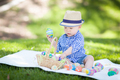 Mixed Race Chinese and Caucasian Baby Boy Outside Wearing Rabbit Ears Playing with Easter Eggs - PhotoDune Item for Sale