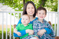 Outdoor Portrait of A Chinese Mother with Her Two Mixed Race Chinese and Caucasian Young Boys - PhotoDune Item for Sale