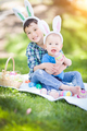 Mixed Race Chinese and Caucasian Boys Outside in Park Playing with Easter Eggs - PhotoDune Item for Sale