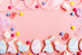 Candies and Easter cookies on pink background. Flat lay mockup with copy space. - PhotoDune Item for Sale