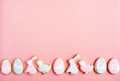 Easter cookies in shape of egg, rabbit and chicken on pink background - PhotoDune Item for Sale
