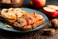 Toasts with peanut butter, apple, banana, walnut and honey. Healthy vegetarian breakfast concept. - PhotoDune Item for Sale