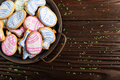 Sugar sprinkles and metal tray with Easter frosted cookies - PhotoDune Item for Sale