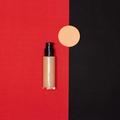Make-up foundation bottle with makeup sponge on red and black - PhotoDune Item for Sale