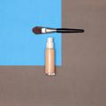 Makeup foundation bottle with make-up brush minimal flat lay - PhotoDune Item for Sale