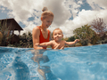 Happy mother and son in the pool - PhotoDune Item for Sale