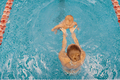 Mother and little son having fun in a swimming pool - PhotoDune Item for Sale
