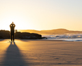 Silhouette of a Person Practicing Yoga on the Beach at Sunrise - PhotoDune Item for Sale