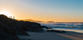 Silhouette of People on a Rock on the Beach Watching the Sunrise - PhotoDune Item for Sale