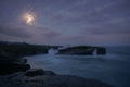 Full moon just before sunrise over the iconic arch of As Catedrais beach - PhotoDune Item for Sale