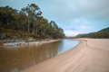 Freshwater channel runs through a beach - PhotoDune Item for Sale