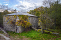 An old stone mill with a vine around the entrance gate - PhotoDune Item for Sale