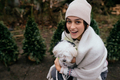 Beautiful young woman with a white dog - PhotoDune Item for Sale