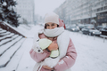 girl with a dog in her arms, snow is falling - PhotoDune Item for Sale