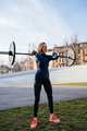 Strong woman exercising with barbell. Sports, fitness concept - PhotoDune Item for Sale