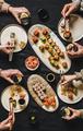 Flat-lay of people eating various sushi during japanese lockdown dinner - PhotoDune Item for Sale
