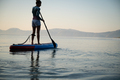 Young woman on sup board - PhotoDune Item for Sale