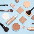 Basic skincare make-up products flat lay. Foundation makeup essentials - PhotoDune Item for Sale