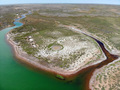 Small red water river and green water lake in Bogdo-Baskunchak Nature Reserve - PhotoDune Item for Sale