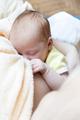 Baby eating breast milk. Concept of breast feeding. - PhotoDune Item for Sale