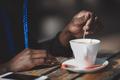 Black woman stirring sugar in a cup - PhotoDune Item for Sale