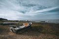 Old fishing boats on the riverbank - PhotoDune Item for Sale
