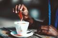 Hands of black girl sugaring coffee - PhotoDune Item for Sale