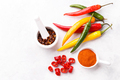 Colorful chili peppers and flakes - PhotoDune Item for Sale