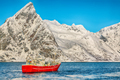 Fishing ships in Lofoten Archipelago near Reinefjorden and  snowy mountaines in background . - PhotoDune Item for Sale