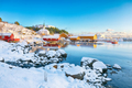 Awesome winter scenery of Moskenes village with ferryport and famous Moskenes parish Churc - PhotoDune Item for Sale