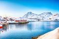 Winter view of small fishing village on Sundstraumen strait and Kakern Bridge - PhotoDune Item for Sale