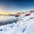 Stunning winter scenery of Moskenes village with ferryport and famous Moskenes parish Churc - PhotoDune Item for Sale