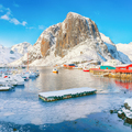 Gorgeous winter view on Hamnoy village with port and Festhaeltinden mountain on background. - PhotoDune Item for Sale
