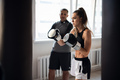 Father is preparing his young daughter for mixed martial arts competitions. The girl hits a punching - PhotoDune Item for Sale