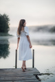 Tender romanitc sentimental female lady in the morning on a wooden pier near the misty river in a - PhotoDune Item for Sale