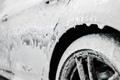 Car wash. The car thresholds is covered with white flowing foam at a carwash - PhotoDune Item for Sale