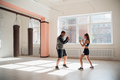 Woman training boxing with personal trainer. Instructor teaching female boxer fighting practice - PhotoDune Item for Sale