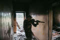 Soldier in full US MARSOC armed with assault rifle run through the abandoned building. Military - PhotoDune Item for Sale