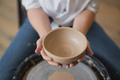 Cuts of product with wire. Craftsman hands making pottery bowl. Woman working on potter wheel - PhotoDune Item for Sale